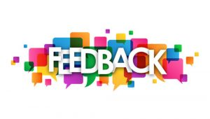 The word feedback in front of coloured geometric shapes